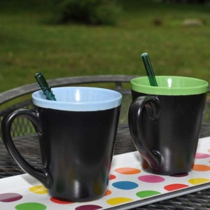 Glass drinking straws in coffee mugs