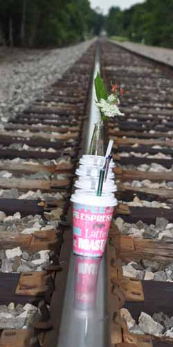 Glass drinking straws on railroad track