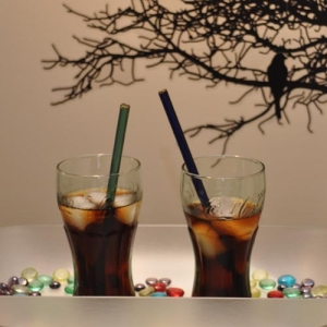 Glass drinking straws in tall coke glasses